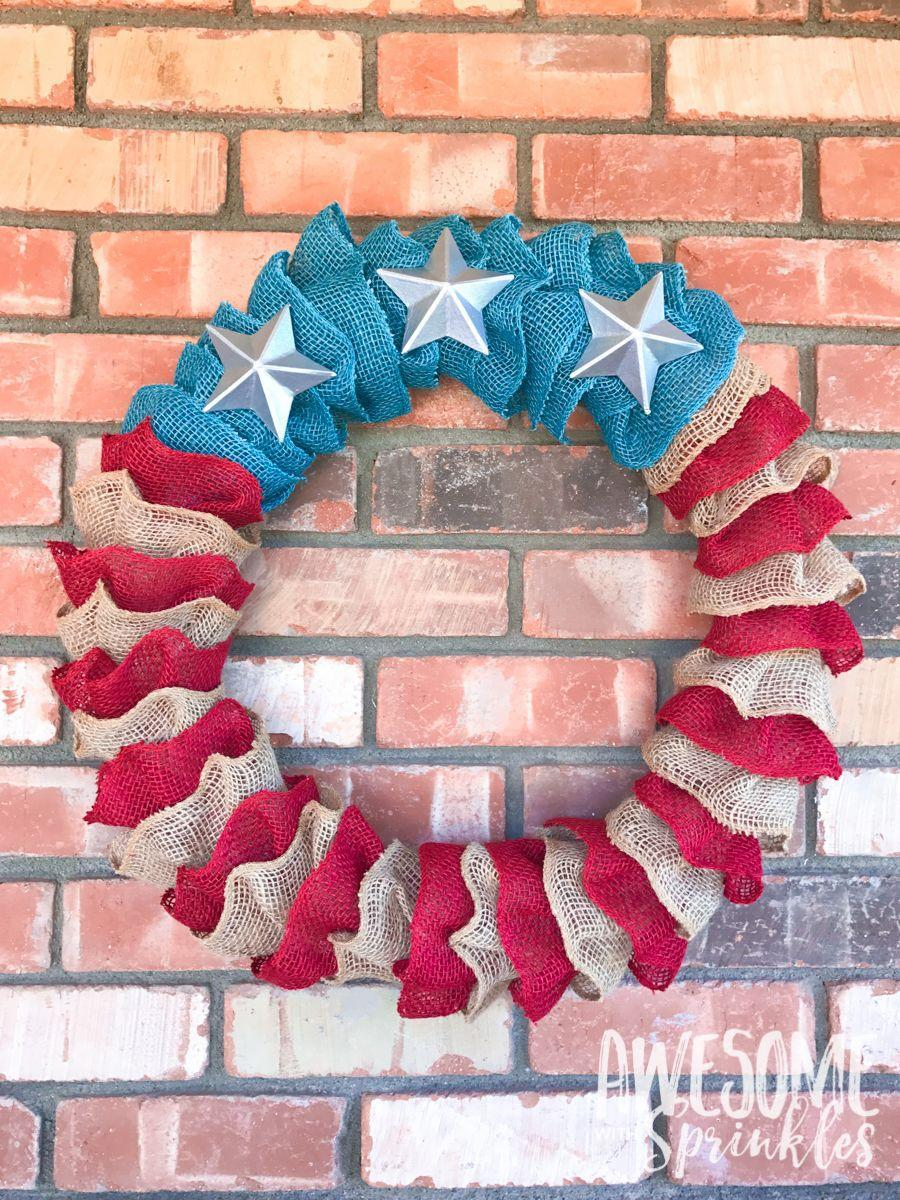 """<p>Made of three colors of burlap, this 4th of July wreath is sturdy enough to hold up for many years to come.</p><p><strong>Get the tutorial at <a href=""""http://www.awesomewithsprinkles.com/stars-stripes-burlap-ruffle-wreath/"""" rel=""""nofollow noopener"""" target=""""_blank"""" data-ylk=""""slk:Awesome With Sprinkles"""" class=""""link rapid-noclick-resp"""">Awesome With Sprinkles</a>.</strong></p><p><strong><a class=""""link rapid-noclick-resp"""" href=""""https://www.amazon.com/Rustic-Patriotic-Burlap-Striped-Ribbon/dp/B07D7JBTVP/ref=sr_1_2?tag=syn-yahoo-20&ascsubtag=%5Bartid%7C10050.g.4464%5Bsrc%7Cyahoo-us"""" rel=""""nofollow noopener"""" target=""""_blank"""" data-ylk=""""slk:SHOP BURLAP RIBBON"""">SHOP BURLAP RIBBON</a></strong></p>"""