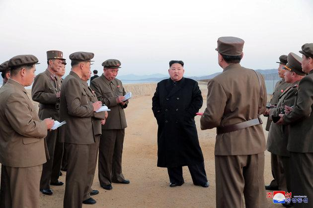 Kim, his officials and their ubiquitous notebooks.