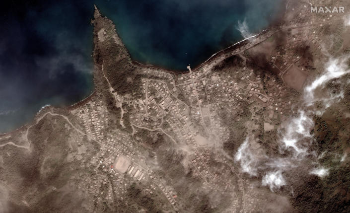 This image provided by Maxar Technologies shows the Richmond Vale waterfront covered in volcanic ash, in Chateaubelair, St. Vincent, Tuesday, April 13, 2021, a day after after another eruption of the La Soufriere volcano. St. Vincent is the biggest of the islands forming St. Vincent and the Grenadines, which gained independence from Britain in 1979 and has a population of about 110,000. (Satellite image ©2021 Maxar Technologies via AP)