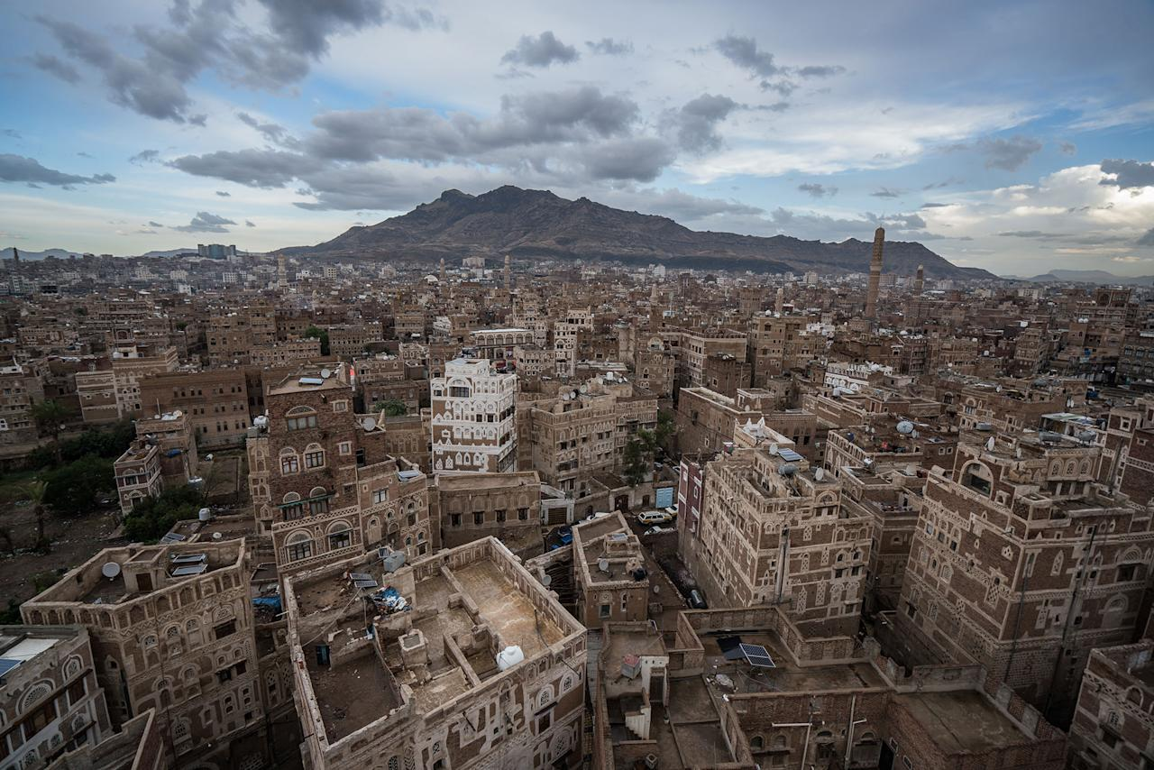 <p>Sana'a' Old City, Yemen, May 7, 2017: The Old City of Sana'a, a UNESCO World Heritage Site, is one of the oldest continually inhabited cities in the world, dating back some 2,500 years. Located in a valley at 2,200 m above sea level, many of the characteristic 'rammed earth' buildings date back to Ottoman rule, which began in the early 1600s. (Photograph by Giles Clarke for UN OCHA/Getty Images) </p>