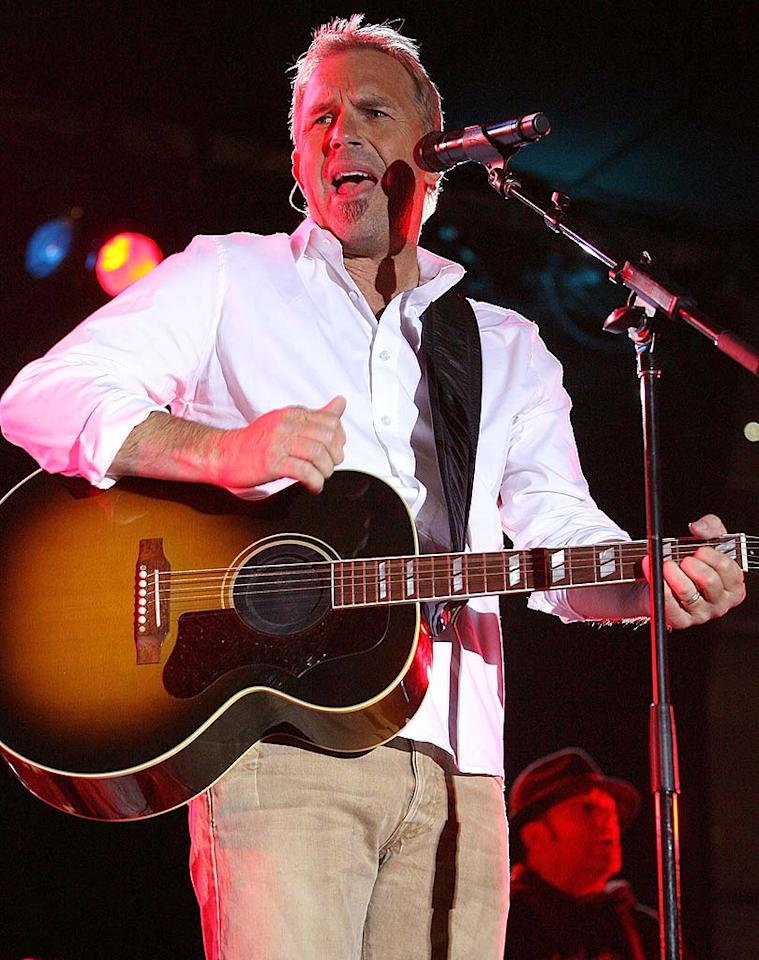 Actor/musician Kevin Costner performs with his band Modern West during the Chevy Kickoff Concert on the day before the 42nd Annual CMA Awards at the Sommet Center Plaza on November 11, 2008 in Nashville, Tennessee. The 42nd Annual CMA Awards - Chevy Kickoff Concert Sommet Center Plaza Nashville, TN United States November 11, 2008 Photo by Frederick Breedon/WireImage.com To license this image (56162746), contact WireImage.com