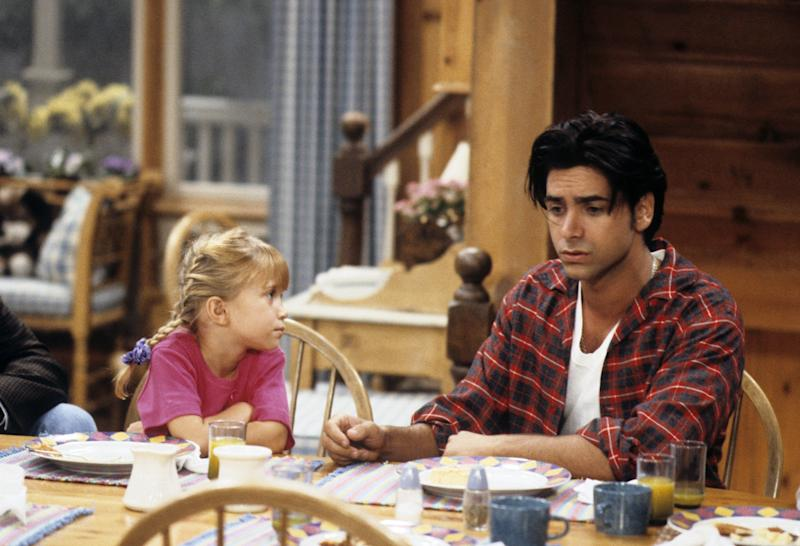 Mary Kate Olsen and John Stamos in the original series.