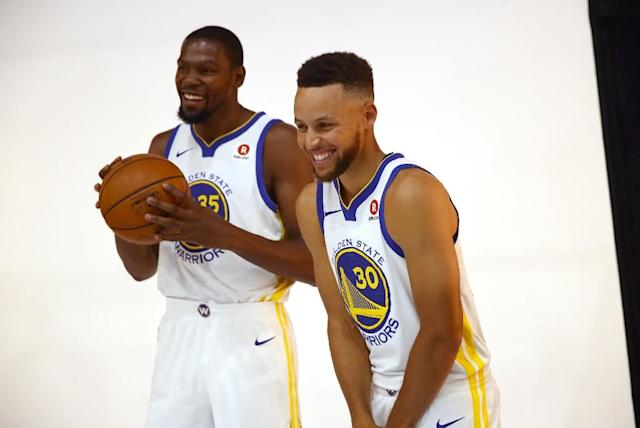 Kevin Durant (L) and Stephen Curry were the star players on the Golden State Warriors's 2017 NBA championship team (AFP Photo/EZRA SHAW)