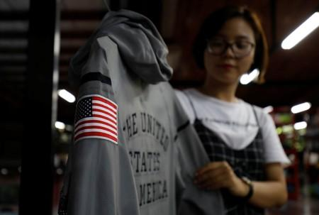 An employee shows a Nike's jacket for USA Olympic 2012 team which was produced by Maxport garment company at its headquarters in Hanoi