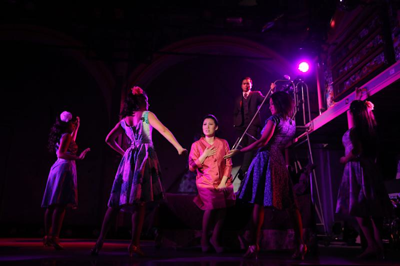 "This undated theater image released by The Public Theater shows Ruthie Ann Miles, center, during a performance of ""Here Lies Love,"" in New York. (AP Photo/The Public Theater, Joan Marcus)"