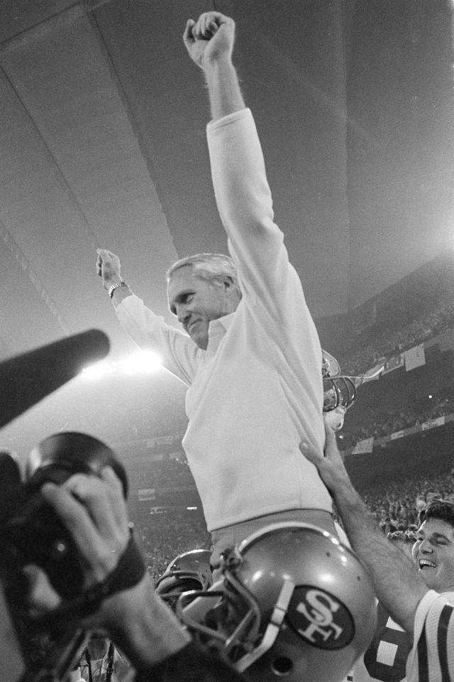 FILE - In this Jan. 25, 1982, file photo, San Francisco 49ers coach Bill Walsh raises his arms in victory as he is carried off the field by his players after their 26-21 Super Bowl XVI win over Cincinnati Bengals in Pontiac, Mich. What doach Kyle Shanahan, quarterback Jimmy Garoppolo, defensive end Nick Bosa and the rest of the San Francisco 49ers are doing this year harkens back to 1981 when Bill Walsh, Joe Montana and Ronnie Lott led the franchise to its first Super Bowl title.(AP Photo/File)