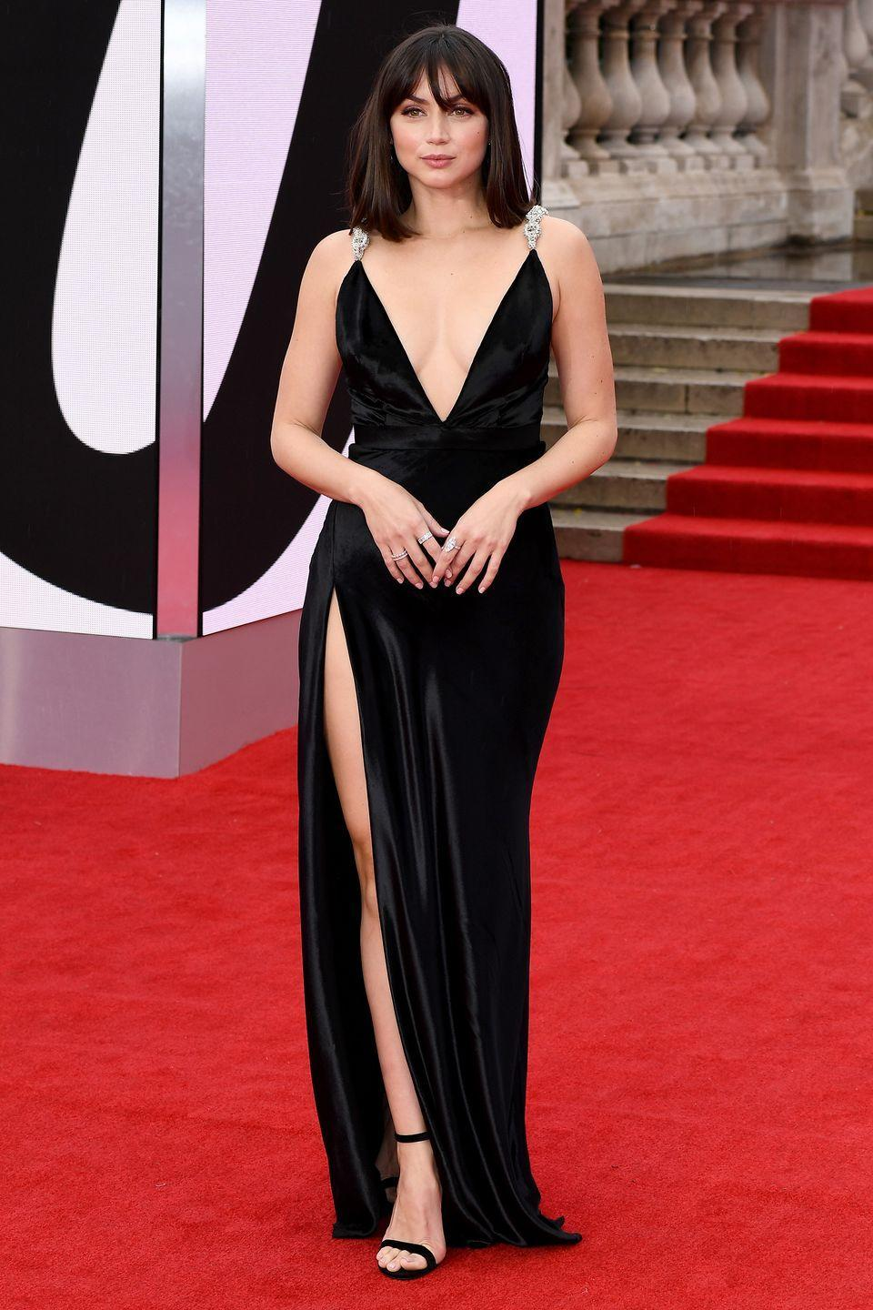 """<p>Ana de Armas wore a silky black Louis Vuitton dress with embellished straps, a look that nodded to the <a href=""""https://www.harpersbazaar.com/uk/fashion/fashion-news/a37771489/no-time-to-die-on-set-ana-de-armas/"""" rel=""""nofollow noopener"""" target=""""_blank"""" data-ylk=""""slk:simple black gown she wears in the film"""" class=""""link rapid-noclick-resp"""">simple black gown she wears in the film</a>. She finished her look with Chopard jewellery.</p>"""