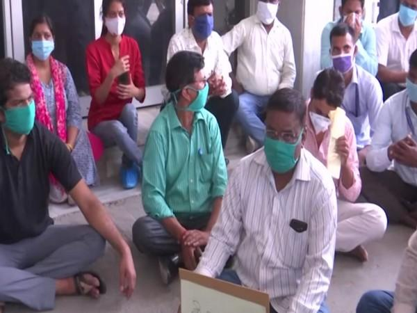 Lab technicians and medical staff sit on protest at BRD Medical College in Gorakhpur on Wednesday. [Photo/ANI]