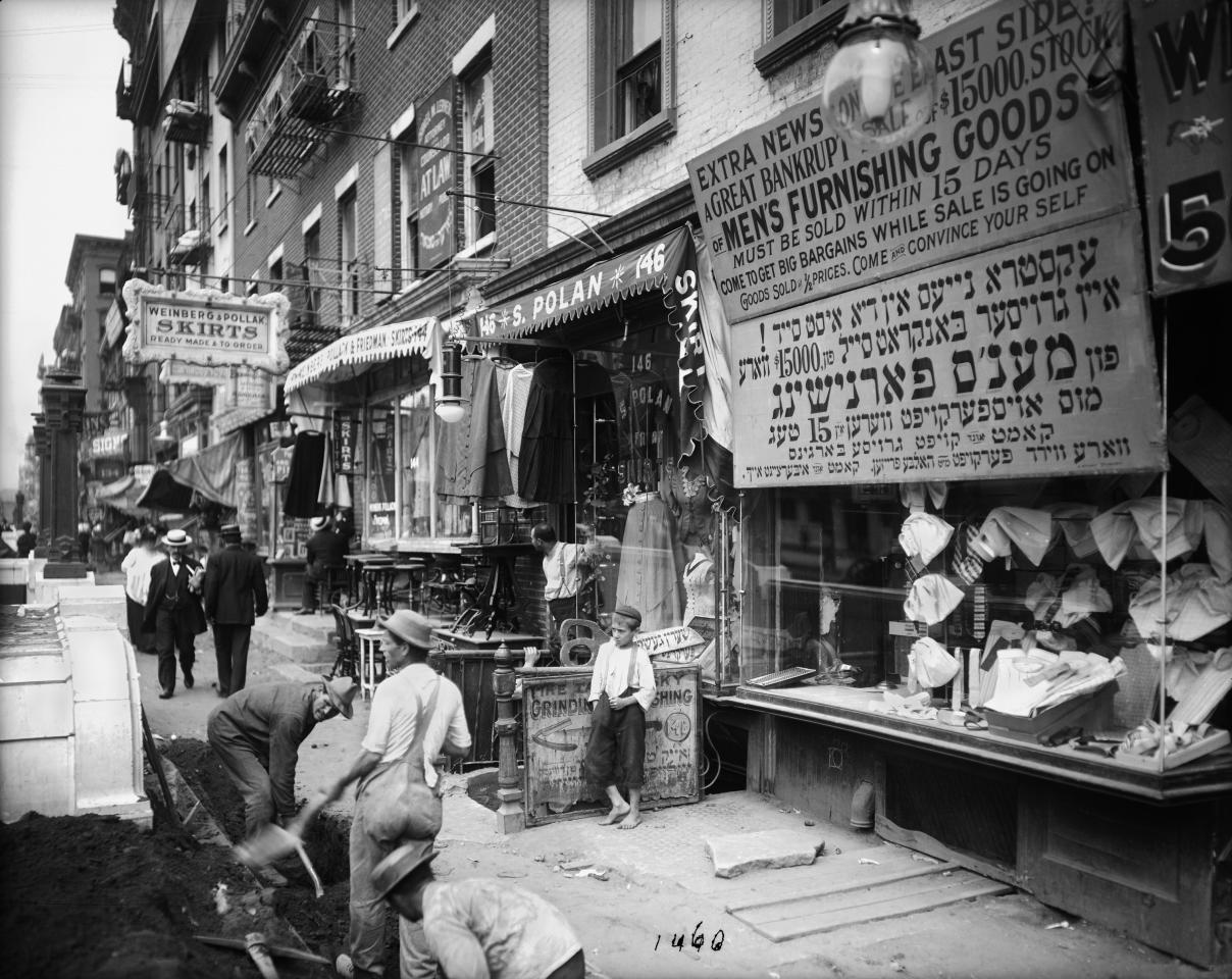 In this July 29, 1908 photo provided by the New York City Municipal Archives, workers dig in the street along the sidewalk on the north side of Delancey Street in New York. Over 870,000 photos from an archive that exceeds 2.2 million images have been scanned and made available online, for the first time giving a global audience a view of this rich collection that documents New York City life.  (AP Photo/New York City Municipal Archives, Department of Bridges/Plant & Structures,  Eugene de Salignac)  MANDATORY CREDIT