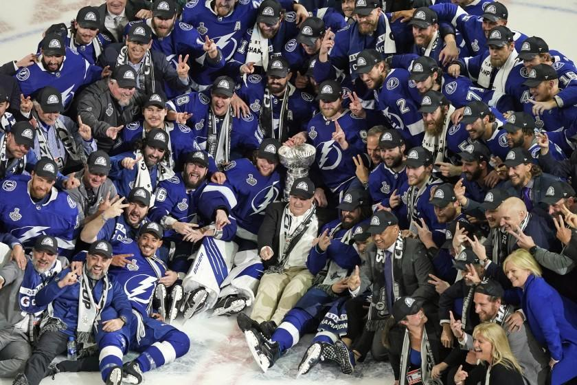 FILE - In this July 7, 2021, file photo, the Tampa Bay Lightning team poses with the Stanley Cup after Game 5