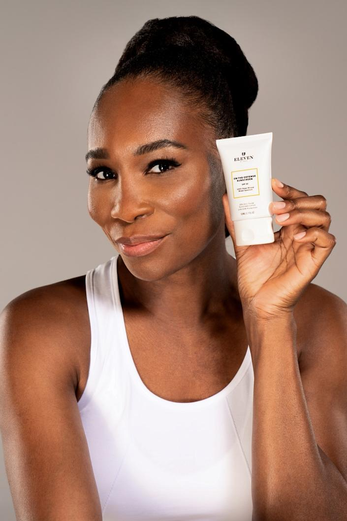 "Tennis star Venus Williams holds sunscreen from her line of sun protection, EleVen by Venus, made for a range of skin tones. <span class=""copyright"">(Craig Ambrosio / Credo Beauty)</span>"