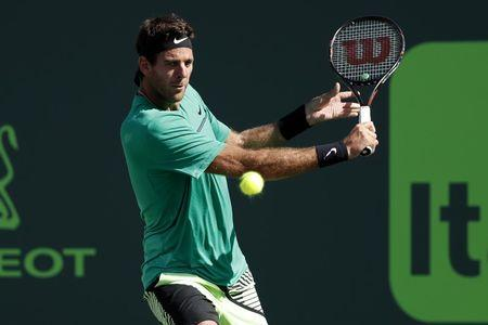 Mar 27, 2017; Miami, FL, USA; Juan Martin del Potro of Argentina hits a backhand against Roger Federer of Switzerland (not pictured) on day seven of the 2017 Miami Open at Crandon Park Tennis Center. Federer won 6-3, 6-4. Mandatory Credit: Geoff Burke-USA TODAY Sports