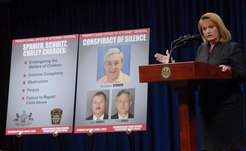 Pennsylvania Attorney General Linda Kelly announces new criminal charges related to an ongoing child sex crimes investigation against former Penn State President Graham Spanier and added charges against two former underlings, Timothy Curley and Gary Schultz during a news conference Thursday, Nov. 1, 2012 at the state capitol in Harrisburg, Pa. Spanier was charged with perjury, obstruction, endangering the welfare of children, failure to properly report suspected abuse and conspiracy. Curley and Schultz face new charges of endangering the welfare of children, obstruction and conspiracy. (AP Photo/Bradley C Bower)