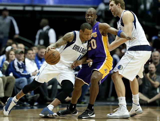 Dallas Mavericks' Monta Ellis (11) drives through Los Angeles Lakers' Jodie Meeks (20) as Dirk Nowitzki, right, sets the pick in the first half of an NBA basketball game, Tuesday, Jan. 7, 2014, in Dallas. (AP Photo/Tony Gutierrez)