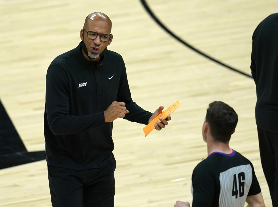 Phoenix Suns head coach Monty Williams, left, argues with referee Ben Taylor (46) during the first half of Game 1 of the NBA basketball Western Conference finals against the Los Angeles Clippers, Sunday, June 20, 2021, in Phoenix. (AP Photo/Ross D. Franklin)