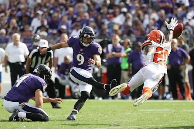 <p>Kicker Justin Tucker #9 of the Baltimore Ravens kicks as strong safety Briean Boddy-Calhoun #20 of the Cleveland Browns blocks him in the four quarter at M&T Bank Stadium on September 17, 2017 in Baltimore, Maryland. (Photo by Rob Carr /Getty Images) </p>