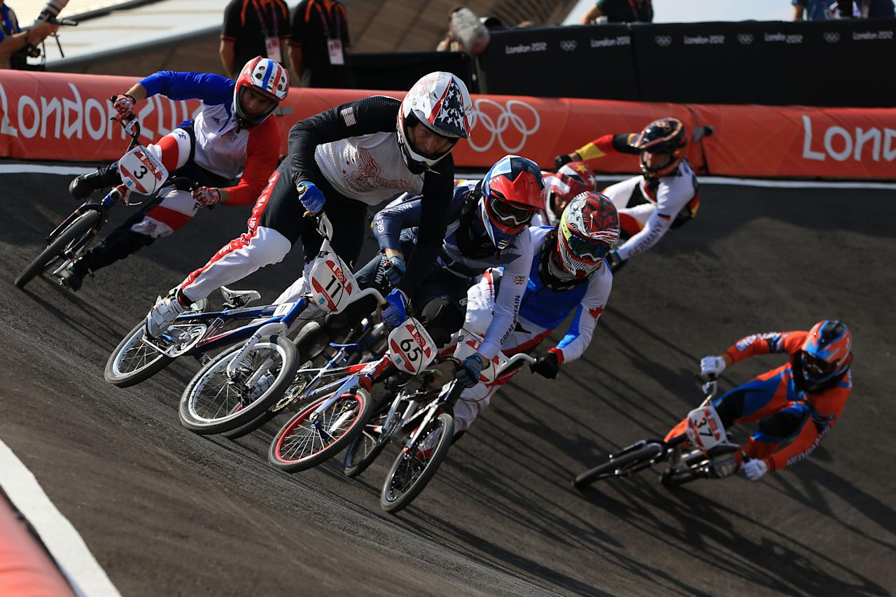 LONDON, ENGLAND - AUGUST 09:  Connor Fields of the United States (2L) leads the field out of the berm during the Men's BMX Cycling Quarter Finals on Day 13 of the London 2012 Olympic Games at BMX Track on August 9, 2012 in London, England.  (Photo by Phil Walter/Getty Images)