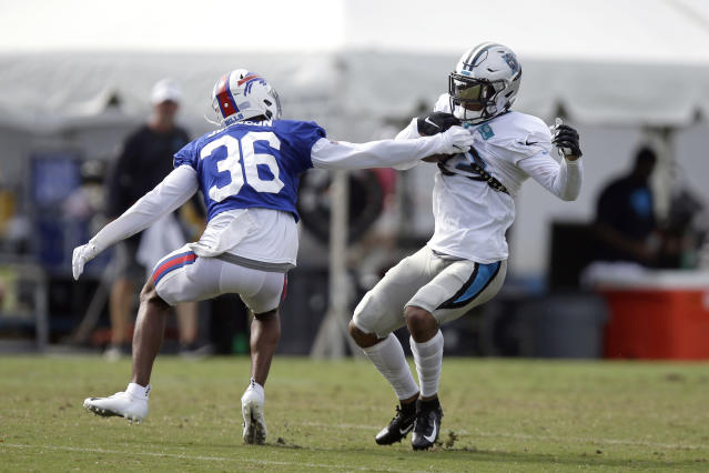 Buffalo Bills' Kevin Johnson (36) reaches for Carolina Panthers' D.J. Moore during an NFL football training camp in Spartanburg, S.C., Wednesday, Aug. 14, 2019. (AP Photo/Gerry Broome)