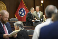 Sen. Mark Pody, R-Lebanon, left, talks with Rep. Scott Cepicky, R-Culleoka, right, before a state legislative committee meeting, Wednesday, July 21, 2021, in Nashville, Tenn. Being discussed amongst other things was the Department of Health vaccine administration following the firing of Dr. Michelle Fiscus, the state's top vaccine official, after state lawmakers complained about efforts to promote COVID-19 vaccination among teenagers. (AP Photo/John Amis)