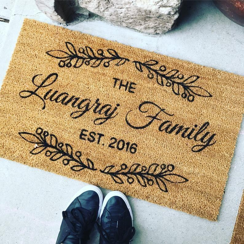 """<p><strong>BlackButterflySigns</strong></p><p>etsy.com</p><p><strong>$32.00</strong></p><p><a href=""""https://go.redirectingat.com?id=74968X1596630&url=https%3A%2F%2Fwww.etsy.com%2Flisting%2F553069279%2Fwelcome-mat-custom-doormat-customized&sref=https%3A%2F%2Fwww.womenshealthmag.com%2Flife%2Fg19924022%2Fbest-gifts-for-parents%2F"""" rel=""""nofollow noopener"""" target=""""_blank"""" data-ylk=""""slk:Shop Now"""" class=""""link rapid-noclick-resp"""">Shop Now</a></p><p>One of the best things about parents is how they have a way of making anyone feel at home. Help yours freshen up their front step with a custom mat that's as welcoming as the people who live there.</p>"""