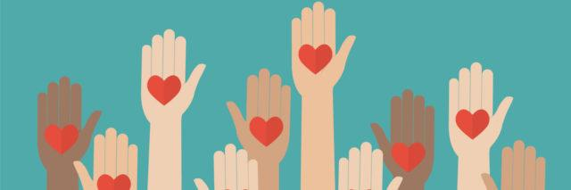 Illustration of raised hands with hearts on them