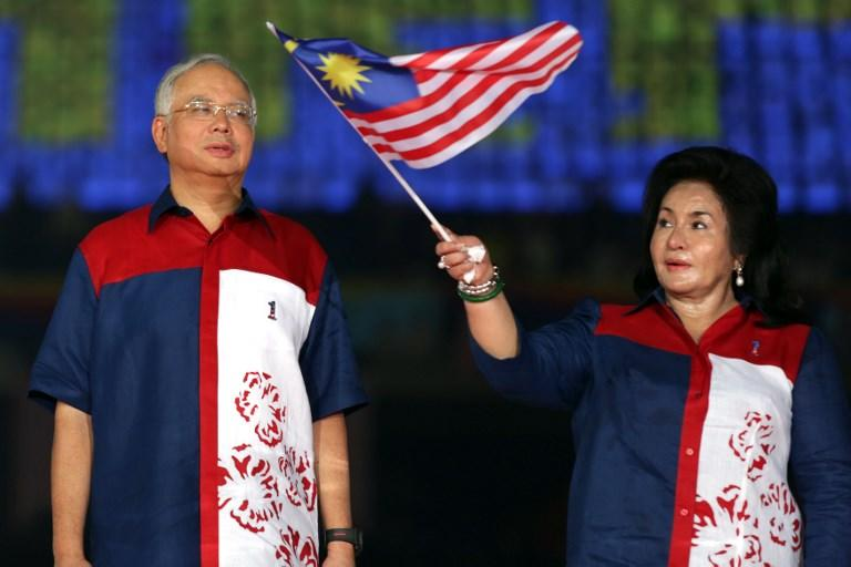 File photo taken on August 31, 2012 shows Malaysia's then-Prime Minister Najib Razak looking on as his wife Rosmah Mansor waves the Malaysia national flag during a rally to celebrate the country's 55th Independence Day.Photo: Mohd Rasfan / AFP