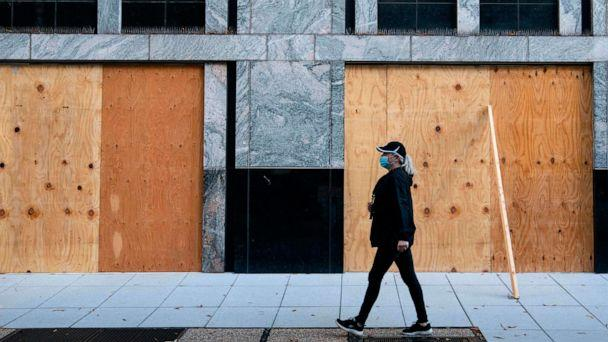 PHOTO: Wooden boards protect a Starbucks location near the White House on Oct. 31, 2020 in Washington, D.C. (Alex Edelman/AFP via Getty Images)