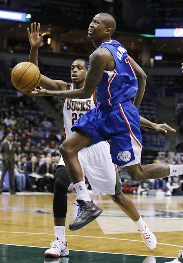 Los Angeles Clippers' Jamal Crawford, right, drives to the basket against Milwaukee Bucks' Khris Middleton (22) during the first half of an NBA basketball game, Monday, Jan. 27, 2014, in Milwaukee. (AP Photo/Jeffrey Phelps)