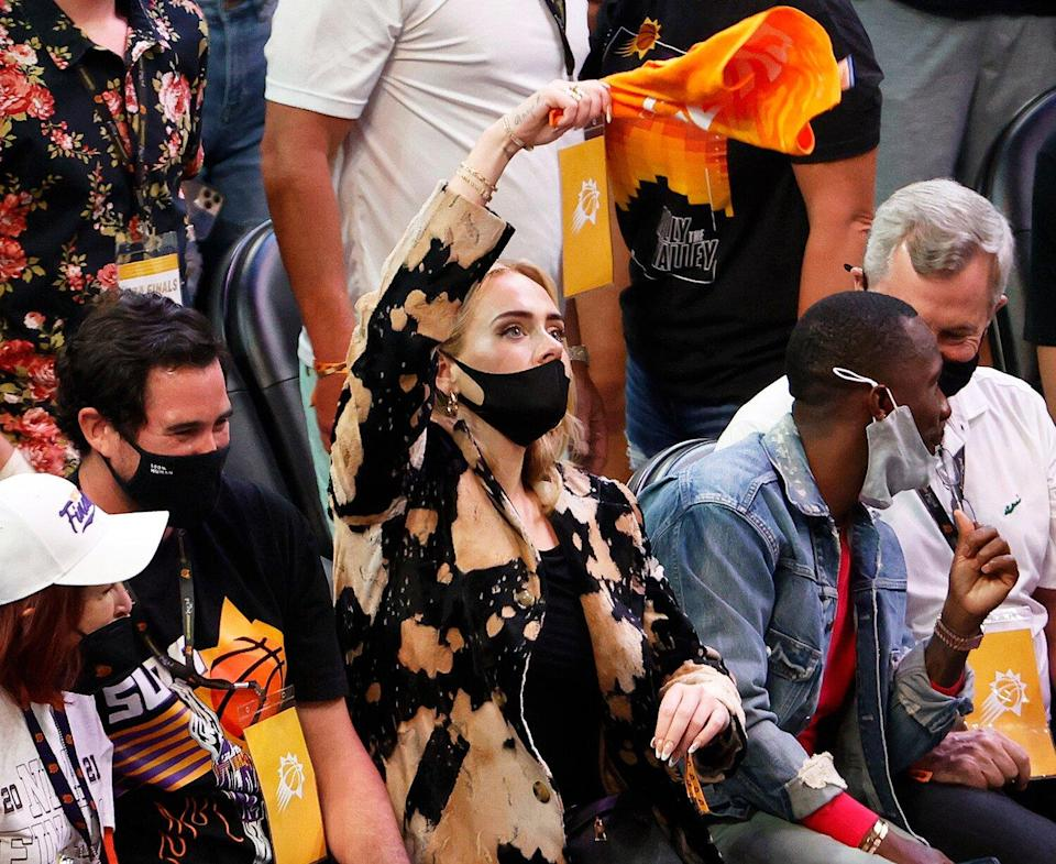 Adele waves a rally towel during the second half in Game Five of the NBA Finals between the Milwaukee Bucks and the Phoenix Suns at Footprint Center on July 17, 2021 in Phoenix, Arizona.
