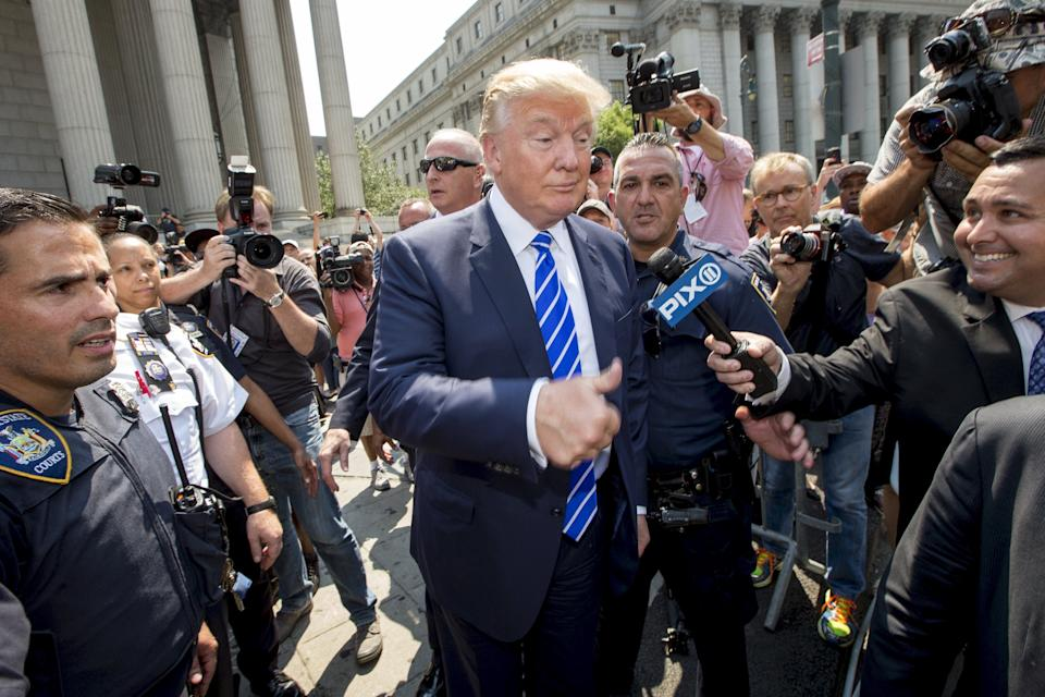 Trump reporting for jury service in Manhattan in 2015REUTERS