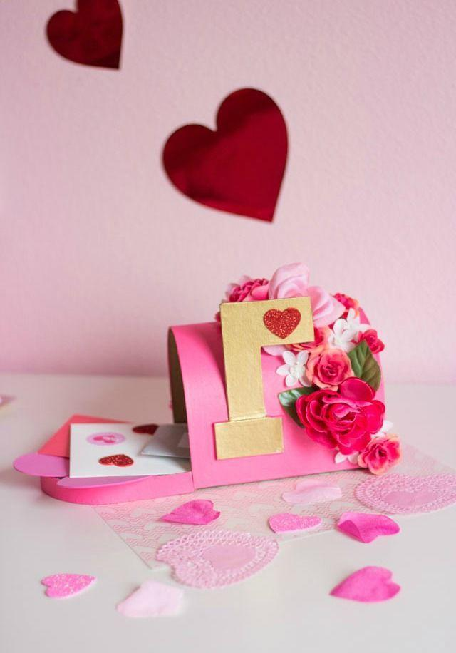 """<p>This charming flower-covered mailbox is perfect to display or collect all your kids' Valentines.</p><p><strong>Get the tutorial at</strong> <a href=""""https://designimprovised.com/2017/02/diy-floral-valentine-mailbox.html"""" rel=""""nofollow noopener"""" target=""""_blank"""" data-ylk=""""slk:Design Improvised."""" class=""""link rapid-noclick-resp""""><strong>Design Improvised. </strong></a></p><p><a class=""""link rapid-noclick-resp"""" href=""""https://www.amazon.com/Mulberry-Water-Based-Blendable-Projects-Ceramics/dp/B08542RZ8D/?tag=syn-yahoo-20&ascsubtag=%5Bartid%7C2164.g.35119968%5Bsrc%7Cyahoo-us"""" rel=""""nofollow noopener"""" target=""""_blank"""" data-ylk=""""slk:SHOP PINK CRAFT PAINT"""">SHOP PINK CRAFT PAINT</a></p>"""