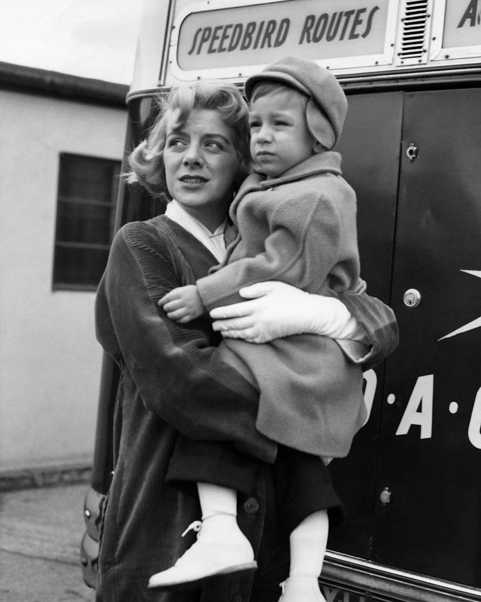 <p>Rosemary holds her son, Miguel Ferrer, at the airport in 1957. </p>