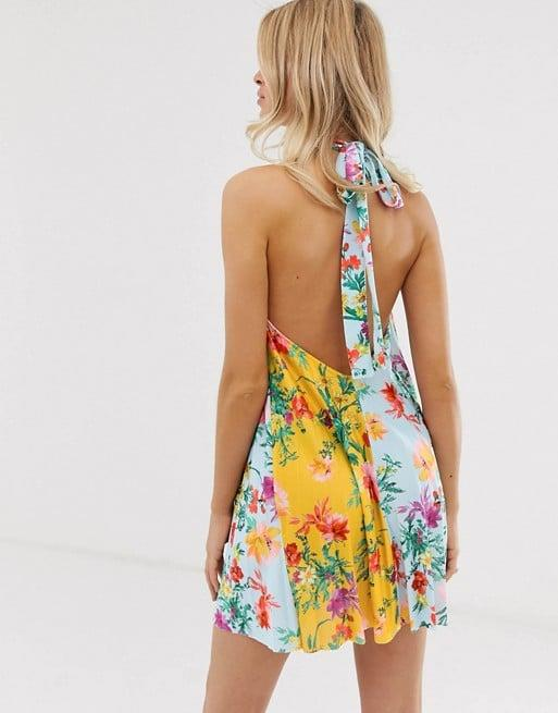"<p>This colorful <a href=""https://www.popsugar.com/buy/ASOS%20DESIGN%20Floral%20Backless%20Halter%20Dress-471324?p_name=ASOS%20DESIGN%20Floral%20Backless%20Halter%20Dress&retailer=us.asos.com&price=34&evar1=fab%3Aus&evar9=46411222&evar98=https%3A%2F%2Fwww.popsugar.com%2Ffashion%2Fphoto-gallery%2F46411222%2Fimage%2F46411832%2FASOS-DESIGN-Floral-Backless-Halter-Dress&list1=shopping%2Casos%2Csale%20shopping%2Caffordable%20shopping&prop13=api&pdata=1"" rel=""nofollow"" data-shoppable-link=""1"" target=""_blank"" class=""ga-track"" data-ga-category=""Related"" data-ga-label=""https://us.asos.com/asos-design/asos-design-floral-backless-halter-pleated-mini-dress/prd/12370130?clr=multi&amp;colourWayId=16413212&amp;SearchQuery=&amp;cid=7046"" data-ga-action=""In-Line Links"">ASOS DESIGN Floral Backless Halter Dress</a> ($34, originally $48) is perfect for a vacation.</p>"