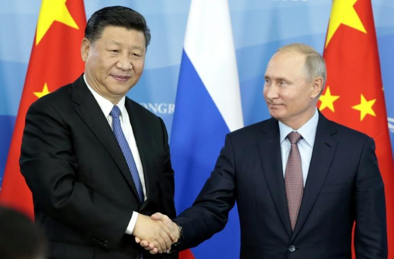 Putin praised Russia's increasingly close ties with China as he met with Xi at the economic forum in Vladivostok
