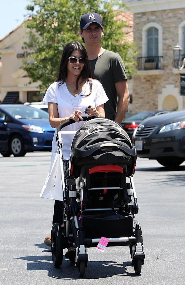 "Kourtney Kardashian and her baby daddy Scott Disick took little Mason out for a stroll in Los Angeles Saturday. The couple appear to be making it work, despite the fact that Scott rarely gets along with her clan. RS/<a href=""http://www.x17online.com"" target=""new"">X17 Online</a> - June 19, 2010"