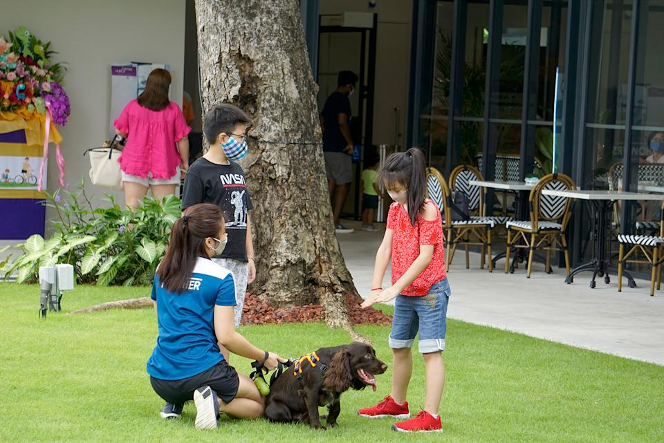 A family with their dog seen at an outdoor cafe at Changi Airport on 11 October 2020. (PHOTO: Dhany Osman / Yahoo News Singapore)