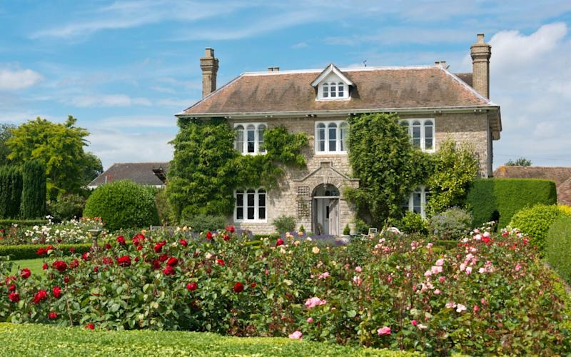 A Picturesque English country cottage with rose garden, located in an English Village. - Chris Mansfield