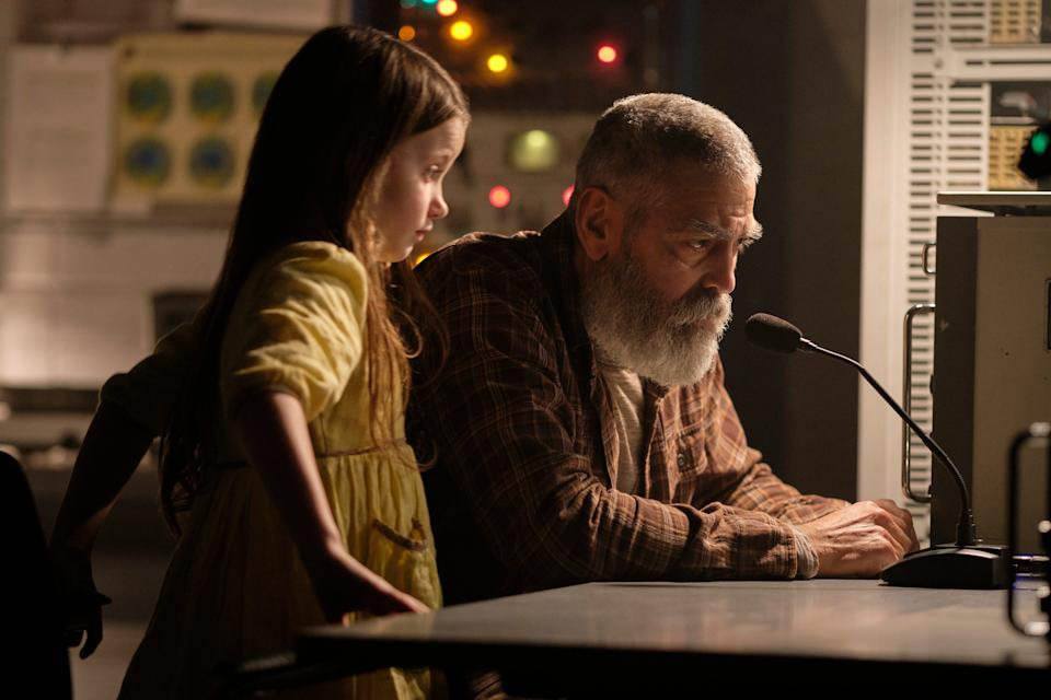 "Augustine (George Clooney, with Caoilinn Springall) attempts to communicate with a returning spaceship in ""The Midnight Sky."""