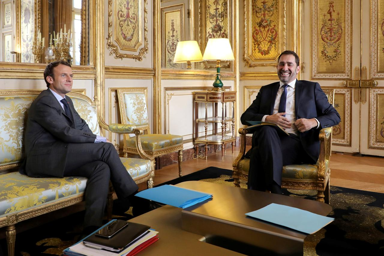 "French President Emmanuel Macron (L) speaks with Christophe Castaner, newly-elected ""La Republique en Marche"" (Republic on the Move, or LREM) political party leader and Junior Minister for Relations with Parliament and government spokesperson Christophe Castaner, during a meeting at the Elysee Palace in Paris, France, November 20, 2017.      REUTERS/Ludovic Marin/Pool"