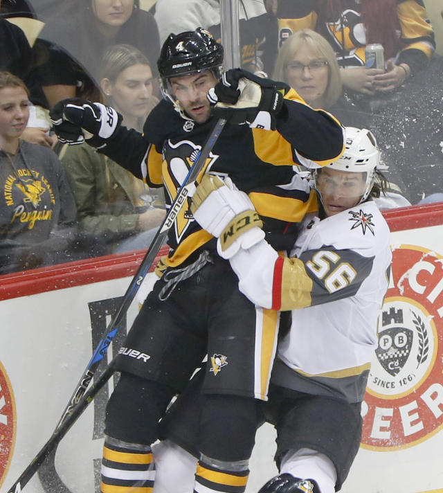 Pittsburgh Penguins' Justin Schultz, left, and Vegas Golden Knights' Erik Haula collide along the boards during the first period of an NHL hockey game Thursday, Oct. 11, 2018, in Pittsburgh. (AP Photo/Keith Srakocic)