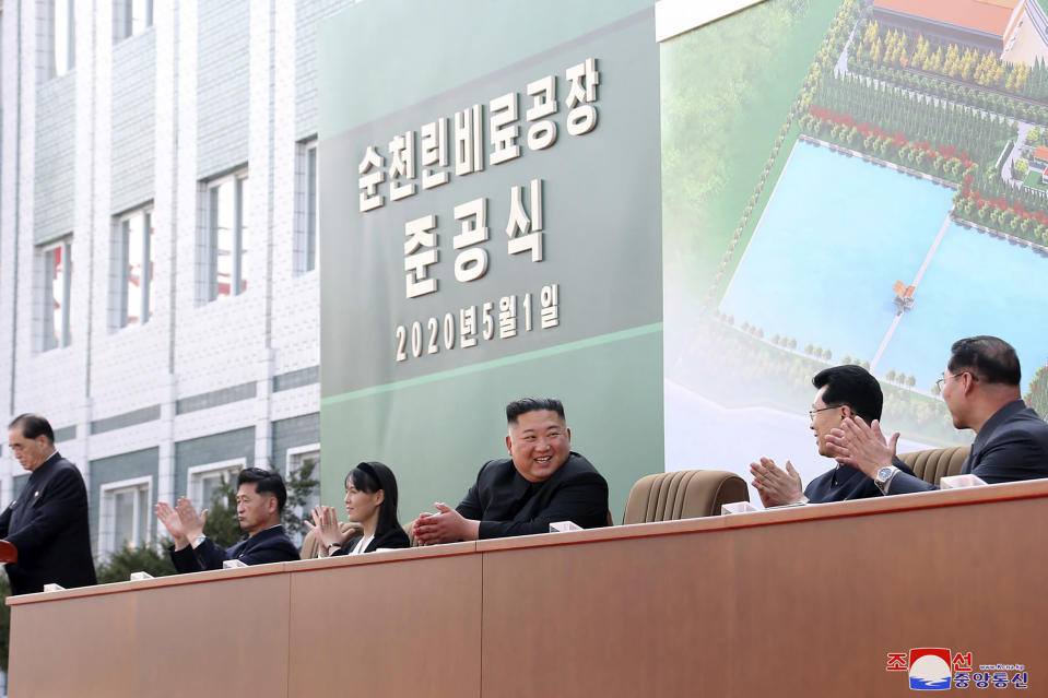 "ADDS CITY AND ID OF WOMAN - In this Friday, May 1, 2020, photo provided by the North Korean government, North Korean leader Kim Jong Un, center, claps with his sister Kim Yo Jong, third from left, during a ceremony at a fertilizer factory in Sunchon, South Pyongan province, near Pyongyang, North Korea. Kim made his first public appearance in 20 days as he celebrated the completion of the fertilizer factory, state media said Saturday, May 2, 2020, ending an absence that had triggered global rumors that he may be seriously ill. Independent journalists were not given access to cover the event depicted in this image distributed by the North Korean government. The content of this image is as provided and cannot be independently verified. Korean language watermark on image as provided by source reads: ""KCNA"" which is the abbreviation for Korean Central News Agency. (Korean Central News Agency/Korea News Service via AP)"