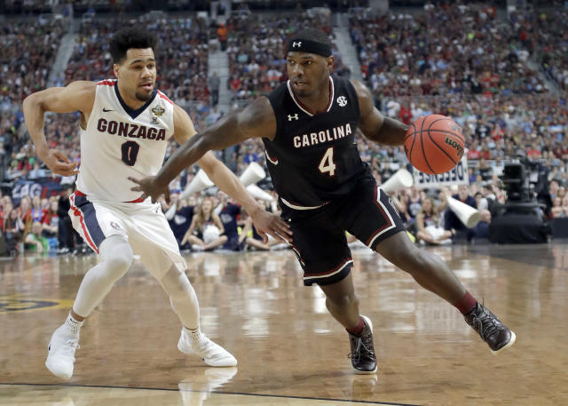 South Carolina's Rakym Felder (4) drives against Gonzaga's Silas Melson (0) during the second half in the semifinals of the Final Four NCAA college basketball tournament, Saturday, April 1, 2017, in Glendale, Ariz. (AP Photo/David J. Phillip)