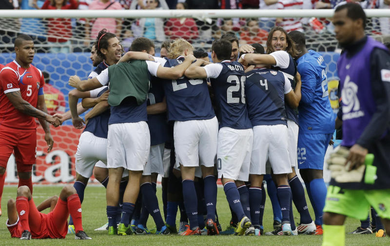 United States players celebrate after defeating Panama 1-0 in the CONCACAF Gold Cup final soccer match at Soldier Field, Sunday, July 28, 2013, in Chicago. (AP Photo/Nam Y. Huh)