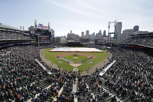 Baseball fans attend the baseball home opener of the Detroit Tigers and the Kansas City Royals game at Comerica Park in Detroit, Monday, March 31, 2014. (AP Photo/Matt Halip)
