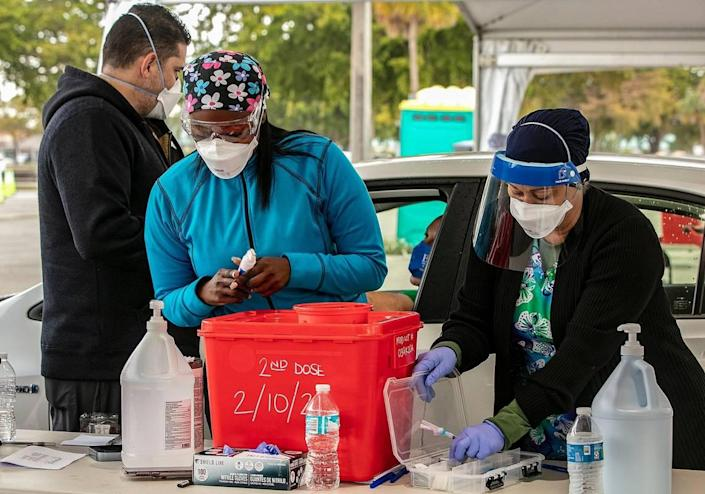 Nurses prepare COVID-19 vaccine shots for Miami-Dade County residents with appointments at Tropical Park in Miami on Wednesday, Jan. 13, 2021.