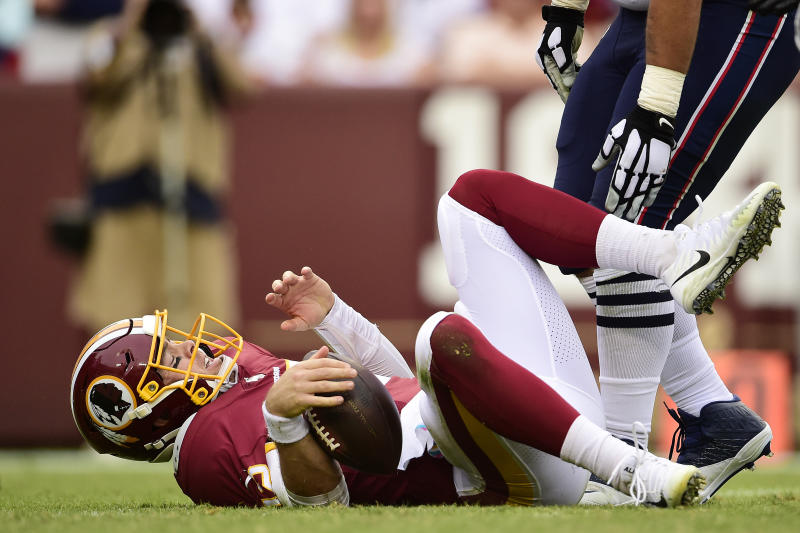 Colt McCoy of the Washington Redskins reacts after being sacked by the New England Patriots. (Getty Images)