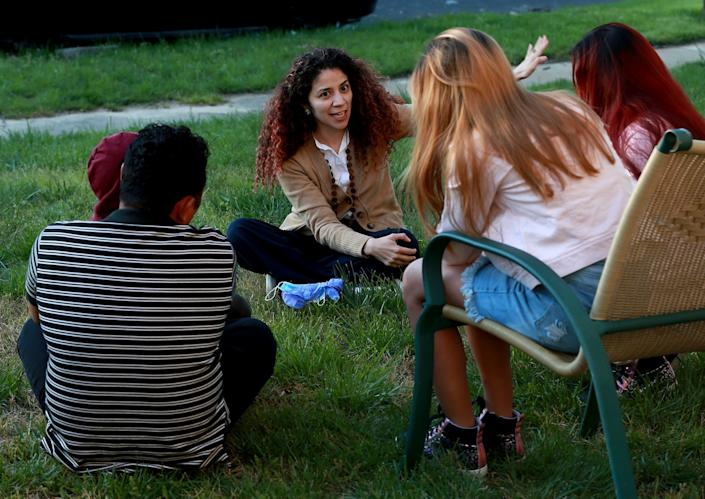 """Attorney Claudia Cubas talks to Jose and his children in April, shortly after they were released from a government shelter. <span class=""""copyright"""">(Kirk McKoy / Los Angeles Times)</span>"""