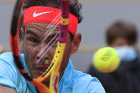 Spain's Rafael Nadal plays a shot against Sebastian Korda of the U.S. in the fourth round match of the French Open tennis tournament at the Roland Garros stadium in Paris, France, Sunday, Oct. 4, 2020. (AP Photo/Michel Euler)
