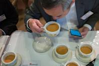 A competition judge takes a sip of milk tea during judging in the Hong Kong Style Milk Tea international final held during the 2016 Hong Kong International Tea Fair on August 13, 2016