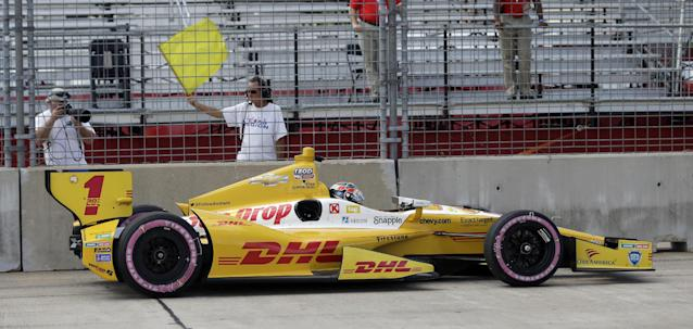 Ryan Hunter-Reay sits in his car after hitting the wall in turn two during practice for the IndyCar Grand Prix of Houston auto race, Friday, Oct. 4, 2013, in Houston. Practice was delayed due to surface issues in turn one. (AP Photo/David J. Phillip)